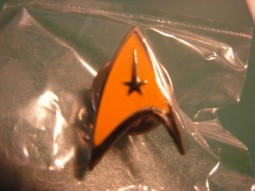 Star trek TOS gold coloured rare pin badge.