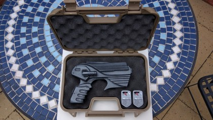 Farscape pistol in case with id badges